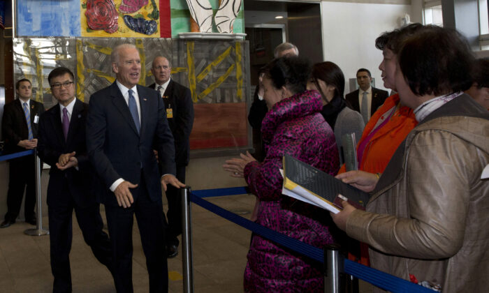 US Vice President Joe Biden meets visa applicants at the U.S. Embassy Consular Section in Beijing, China on Dec. 4, 2013. (NG HAN GUAN/AFP via Getty Images)