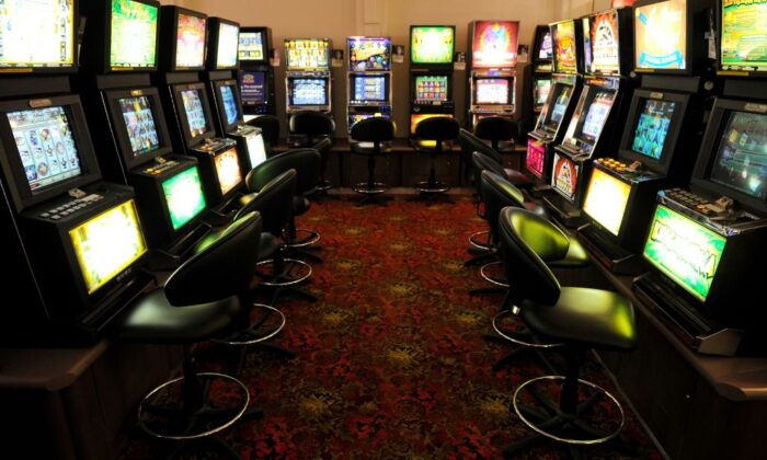 A photo taken in Melbourne on April 13, 2011, shows a general view taken inside a gaming venue with poker machines. (WILLIAM WEST/AFP via Getty Images)