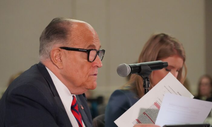 President Donald Trump's lawyer lawyer and former New York City Mayor Rudy Giuliani speaks at a public hearing on election integrity in Phoenix, Ariz., on Nov. 30, 2020. (Mei Lee/The Epoch Times)