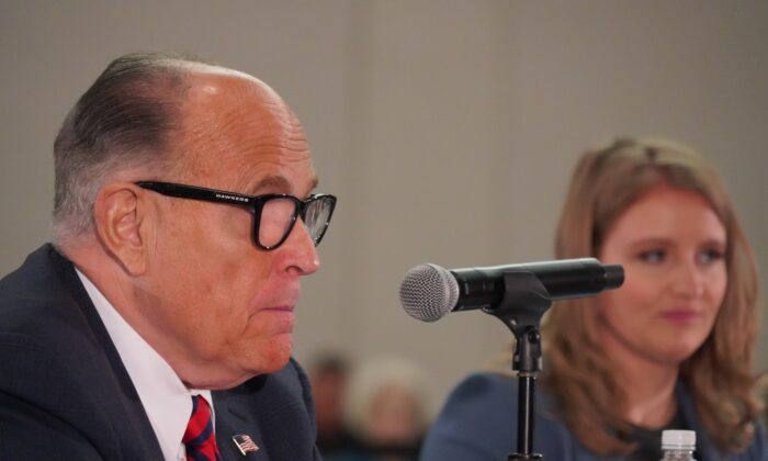 President Donald Trump's lawyer Rudy Giuliani (L), with Trump campaign lawyer Jenna Ellis, testifies during a public hearing on election integrity in Phoenix, Ariz., on Nov. 30, 2020. (Mei Lee/The Epoch Times)