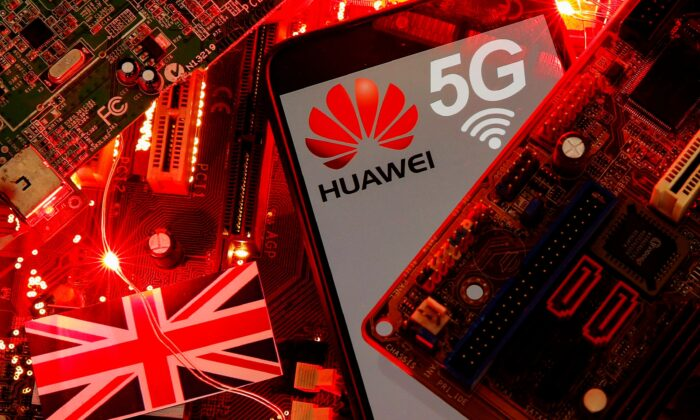 The British flag and a smartphone with a Huawei and 5G network logo are seen on a PC motherboard in this illustration picture taken on Jan. 29, 2020. (Dado Ruvic/Illustration/File Photo/Reuters)