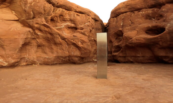 In this still image from video, a metal monolith is seen in Red Rock Desert, Utah on Nov. 25, 2020. (@davidsurber_ via Reuters)