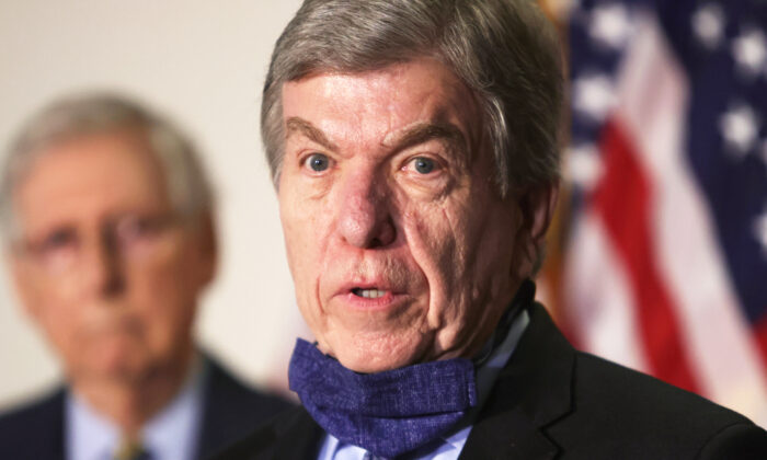 U.S. Sen. Roy Blunt (R-Mo.) speaks to the media as Senate Majority Leader Mitch McConnell (R-Ky.) looks on after the weekly Republican policy luncheon at Hart Senate Office Building on Capitol Hill in Washington on Sept. 22, 2020. (Alex Wong/Getty Images)