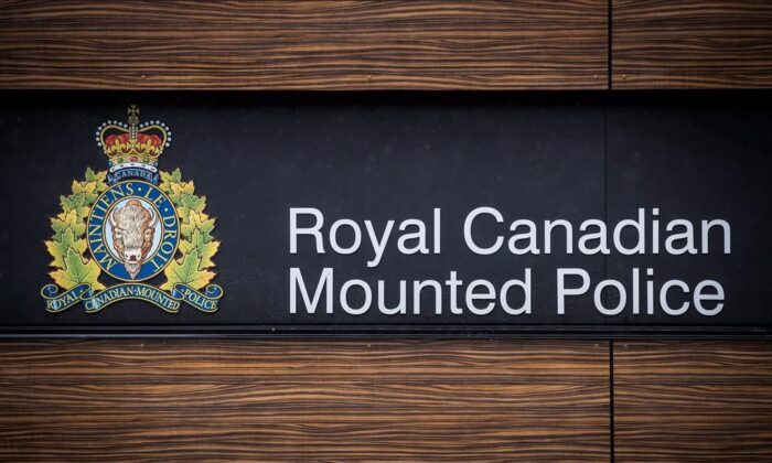 "The RCMP logo is seen outside Royal Canadian Mounted Police ""E"" Division Headquarters, in Surrey, B.C., on April 13, 2018. (The Canadian Press/Darryl Dyck)"