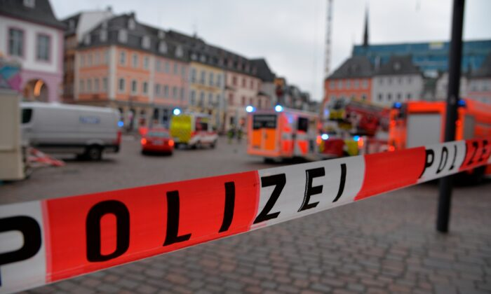 German police block a square after a driver drove into a pedestrian zone killing two and seriously injuring 15 in Trier, German, on Dec. 1, 2020. (Harald Tittel/dpa via AP)