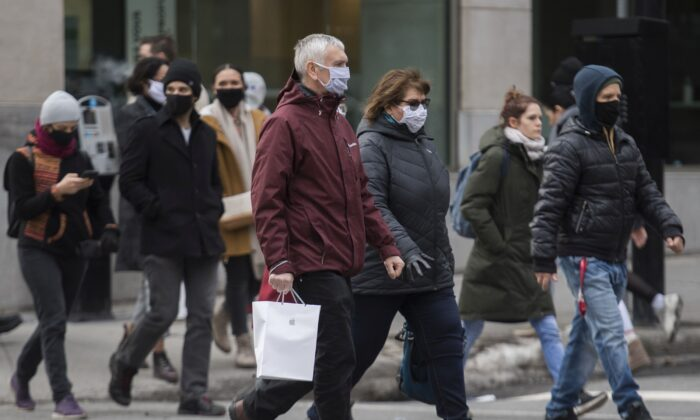 People walk along a street in Montreal on Nov. 29, 2020, as a partial COVID-19 lockdown continues in Quebec. (The Canadian Press/Graham Hughes)