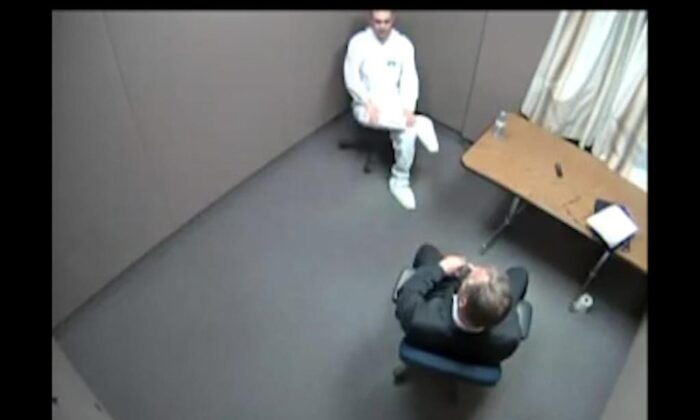 Alek Minassian, top, is seen during a police interview in a still frame taken from handout video footage. (The Canadian Press/HO-Superior Court of Justice, *MANDATORY CREDIT*)