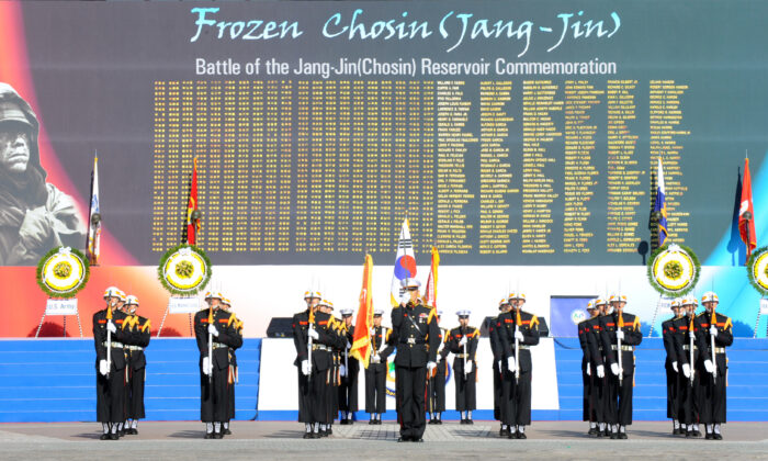 A South Korean Marine honor guard holds a ceremony for the Battle of the Chosin (Jangjin) reservoir commemoration in Seoul on Nov. 10, 2010. (Park Ji-Hwan/AFP via Getty Images)
