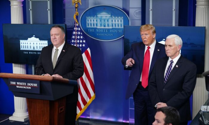US President Donald Trump (C), Secretary of State Mike Pompeo (L), and US Vice President Mike Pence, take a question during the daily briefing on the novel coronavirus at the White House in Washington on April 8, 2020. (Mandel Ngan/AFP via Getty Images)