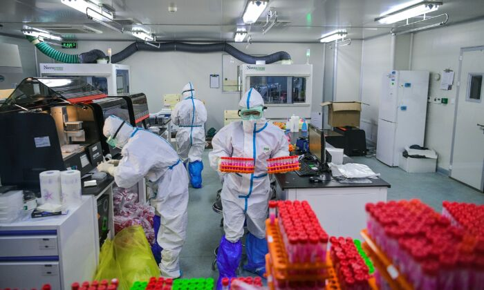 Technicians are processing CCP virus tests at a laboratory in Tianjin, China on Nov. 23, 2020. (STR/CNS/AFP via Getty Images)