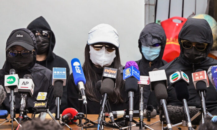 """Family members of the """"Hong Kong 12"""" hold a press conference in Hong Kong on Dec. 28, 2020. (Peter Parks/AFP via Getty Images)"""