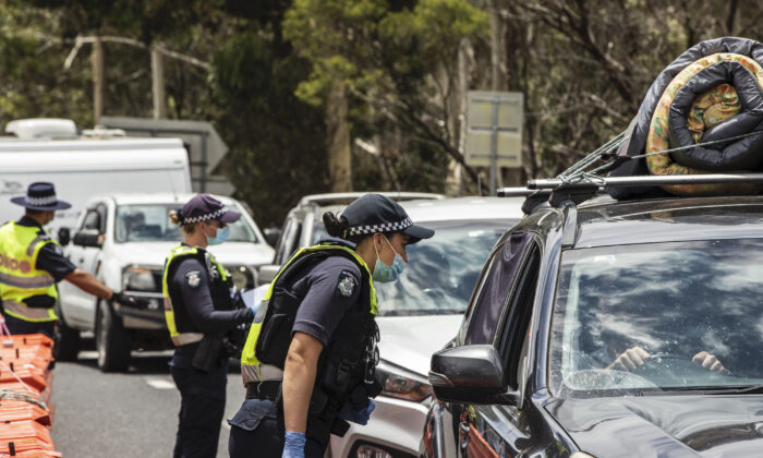 Police officers patrol and check for entry permits to Victoria at a border checkpoint in Mallacoota, Australia on Dec. 29, 2020. (Diego Fedele/Getty Images)