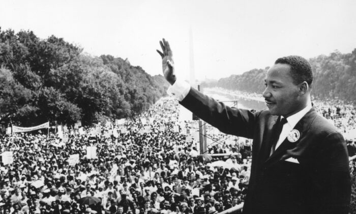 "Martin Luther King addresses crowds during the March on Washington at the Lincoln Memorial, where he gave his ""I Have A Dream"" speech in Washington on Aug. 28, 1963. (Central Press/Getty Images)"