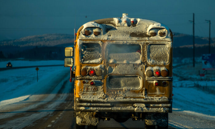 A school bus makes it's way during morning's freezing temperatures reaching bellow 25 degrees Celsius on Trans Canada Highway #1 east of Cochrane , Canada, on Dec. 4, 2013. (Joe Klamar/AFP via Getty Images)