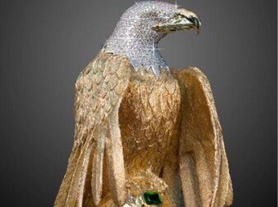A golden eagle sculpture is shown in a handout photo from Delta Police. A legal battle over a missing diamond-encrusted eagle statue valued at nearly $1 million will continue, more than four years after the artwork was allegedly stolen during a robbery in Delta, British Columbia. (The Canadian Press/HO-Delta Police Mandatory Credit)