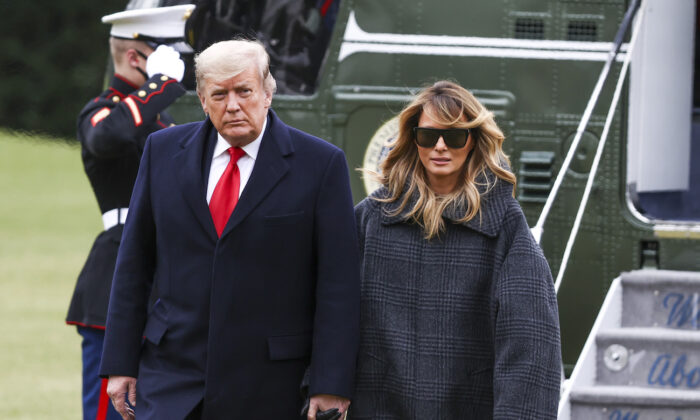 President Donald Trump and First Lady Melania Trump depart Marine One on the South Lawn of the White House in Washington on Dec. 31, 2020. (Tasos Katopodis/Getty Images)