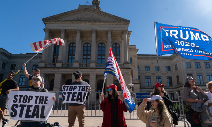Pro-President Donald Trump protesters rally against the results of the presidential election outside the Georgia State Capitol in Atlanta, Ga., on Nov. 18, 2020. (Elijah Nouvelage/Getty Images)