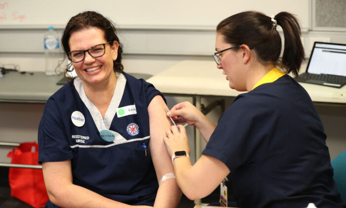 Registered nurse Heather Hoppe receives a BCG injection in the trial clinic at Sir Charles Gairdner hospital Perth, Australia on April 20, 2020. (Paul Kane/Getty Images)