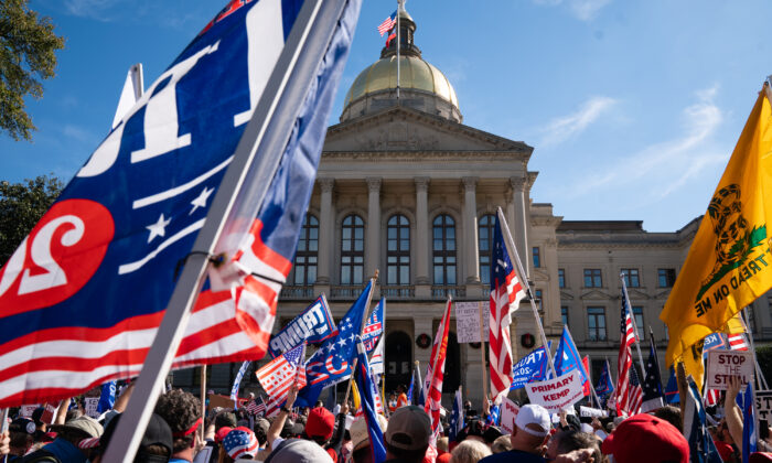 "Protesters rally outside the Georgia State Capitol during a ""March for Trump"" in Atlanta, Ga., on Nov. 21, 2020. (Elijah Nouvelage/Getty Images)"