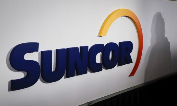 A Suncor logo is shown at the company's annual meeting in Calgary on May 2, 2019. (The Canadian Press/Jeff McIntosh)