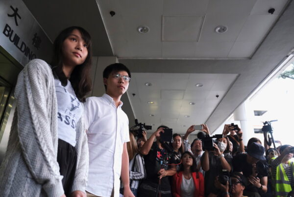Pro-democracy activists Joshua Wong and Agnes Chow leave the Eastern Court after being released on bail over charged with unauthorised assembly near the police headquarters during anti-government protests in Hong Kong