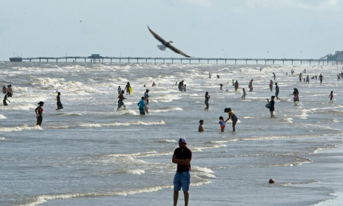 Beachgoers enjoy a day of sunshine in Galveston, Texas, on May 2, 2020. (Mark Felix/AFP/AFP via Getty Images)