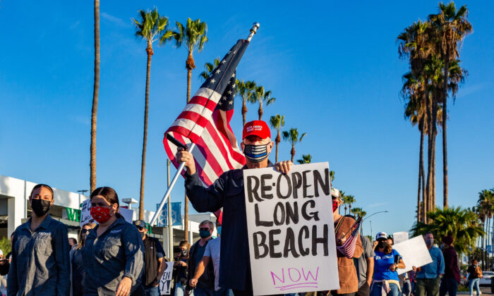 Demonstrators gathered peacefully to march along several blocks of Second Street  in Long Beach, Calif., on Dec. 2. (John Fredricks/The Epoch Times)