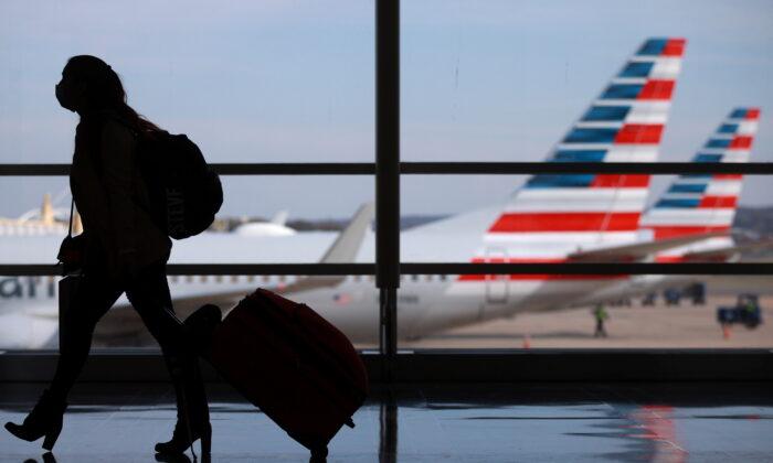 A person walks at Reagan National Airport ahead of the Thanksgiving holiday in Arlington, Va., on Nov. 25, 2020. (Hannah McKay/Reuters)