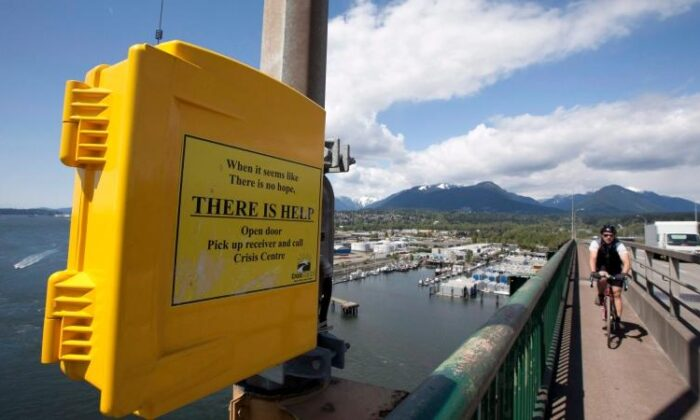 A suicide prevention phone is seen on the Iron Workers Memorial Bridge in North Vancouver on May 10, 2012. (The Canadian Press/Jonathan Hayward)