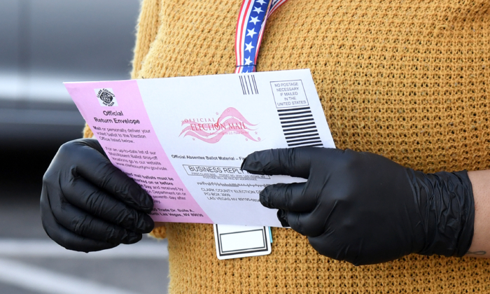 Clark County Election Department worker Breanna Silas accepts ballots at the Clark County Election Department, which serves as a drive-up and walk-up election ballot drop-off point on October 13, 2020 in North Las Vegas, Nevada. (Ethan Miller/Getty Images)