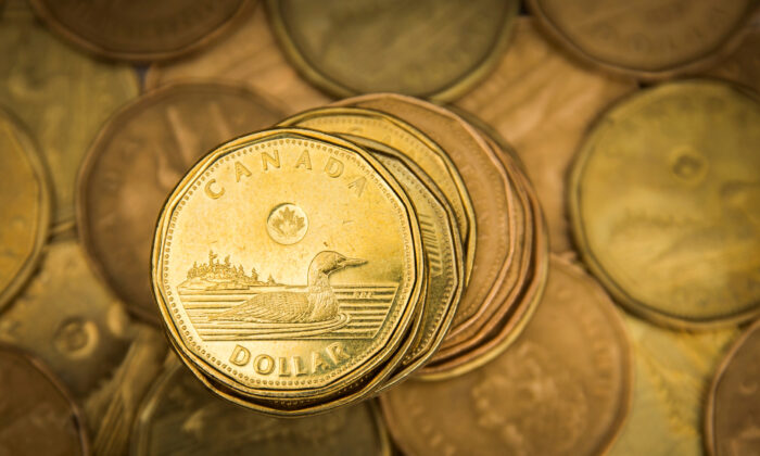"""A Canadian dollar coin, commonly known as the """"Loonie"""", is pictured in this illustration picture taken in Toronto, on Jan. 23, 2015. (Reuters/Mark Blinch/File Photo)"""