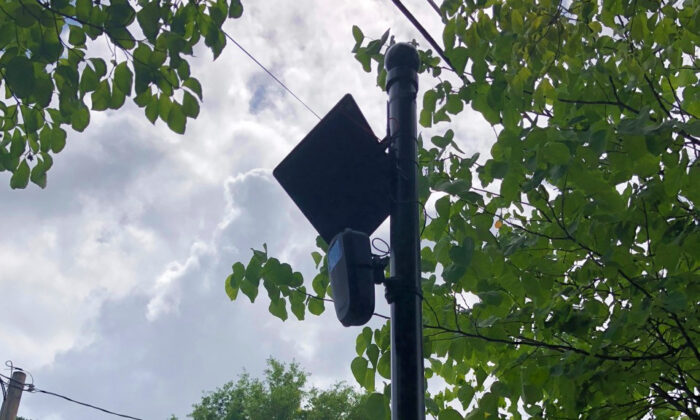 A file photo shows a solar-powered camera used by law enforcement officials to identify license plate numbers that will be installed at intersections in Lake Forest, Calif. (Courtesy of Flock Safety)
