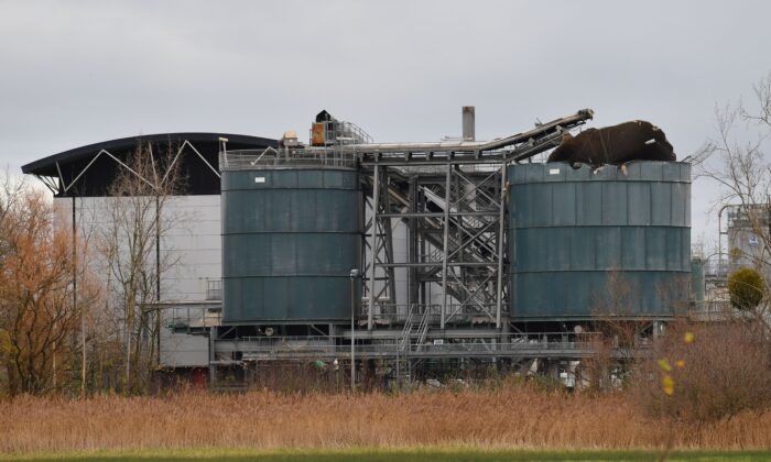A picture shows a damaged silo (R) at a waste water treatment plant in Avonmouth, near Bristol in southwest England, on Dec. 4, 2020, after an explosion the previous day. (Ben Stansall/AFP via Getty Images)