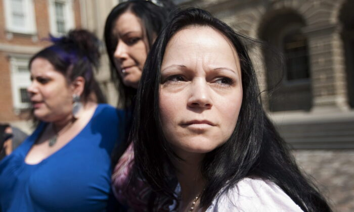Timea Nagy (R), a former sex slave and victim of human trafficking, joins other former sex workers and activists against the legalization of prostitution while speaking to reporters outside the Court of Appeal for Ontario in Toronto, on June 17, 2011. (Darren Calabrese/The Canadian Press)
