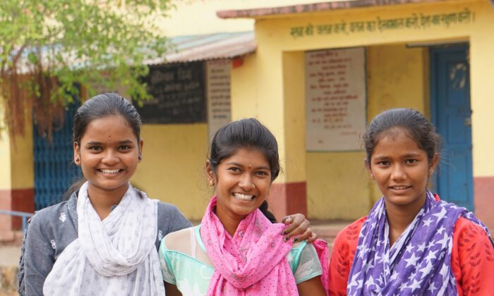 Bhagyshri, 16 (L), Mayari Pandhari Motiwad, 16 (C), and Aisha, 15 (R), at their school at Malhippangee, Maharashtra, India, on Nov. 27, 2020. Motiwad's parents were going to force her to marry during the COVID-19 lockdown, but the other two convinced her parents to let her continue her studies. (Venus Upadhayaya/Epoch Times)