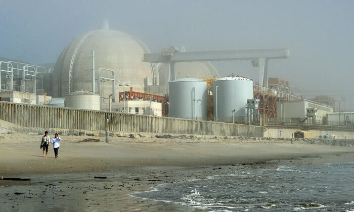Japanese reporters leave the San Onofre Nuclear Power Plant in north San Diego County, Calif., on March 15, 2011.  (Mark Ralston/AFP via Getty Images)