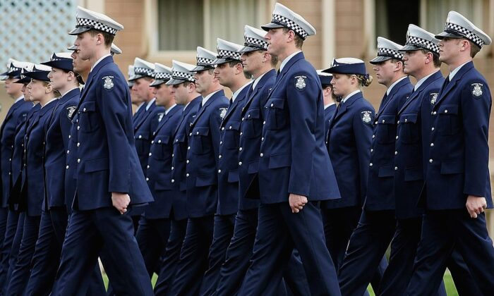 Police academy graduates from the Australian state of Victoria march during a graduation ceremony at the Victorian Police Academy on September 01, 2006 in Melbourne, Australia.  (Quinn Rooney/Getty Images)