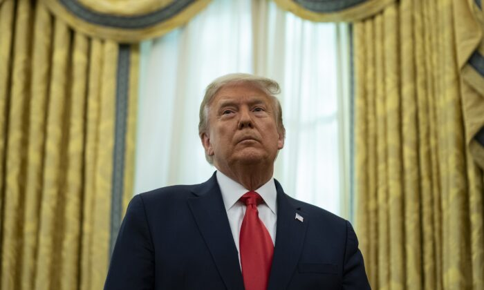 President Donald Trump listens during a ceremony in the Oval Office of the White House in Washington on Dec. 3, 2020. (Evan Vucci/AP Photo)