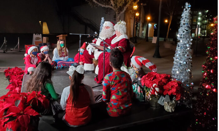 Santa and Mrs. Claus read a story to children as part of the annual Nutcracker Christmas Tree Lighting ceremony in Anaheim, Calif., on Dec. 3, 2020. (Courtesy of the City of Anaheim)