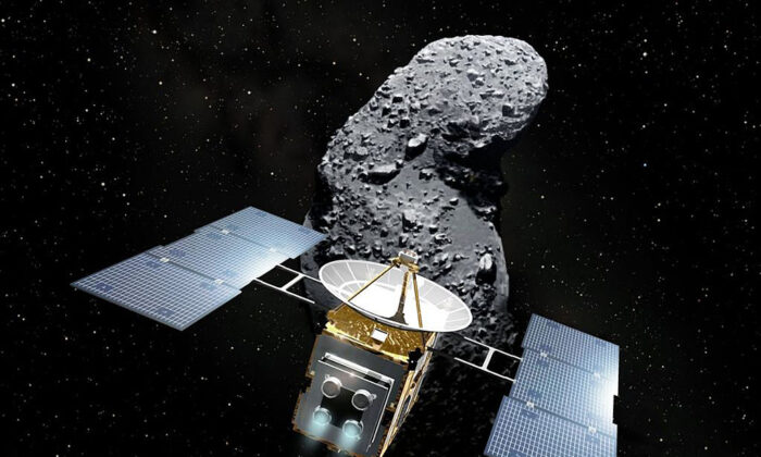 "This imaginary image, illustrated by Akihiro Ikeshita and released from Japan Aerospace Exploration Agency (JAXA) shows Japan's space probe ""Hayabusa"" (Falcon) and an asteroid, called Itokawa in the space. (Akihiro IKESHITA/ Getty Images)"