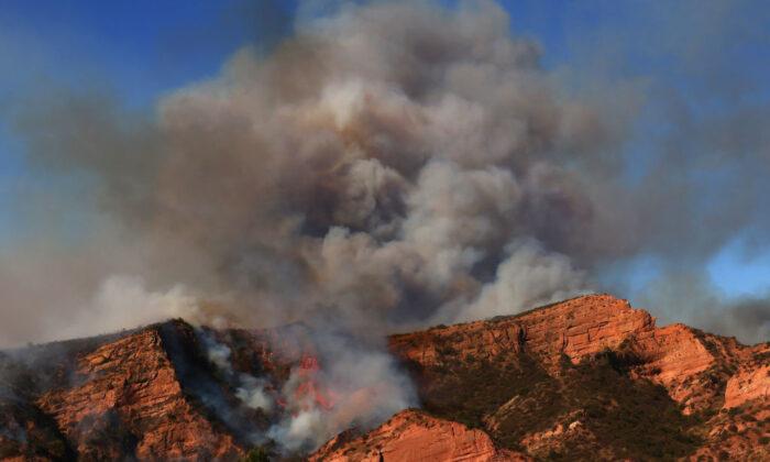The Bond Fire burns in the Silverado Canyon area of Orange County near Irvine, Calif., on Dec. 3, 2020. (Mario Tama/Getty Images)