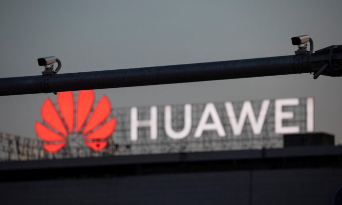 Surveillance cameras are seen in front of a Huawei logo in Belgrade, Serbia, Aug. 11, 2020. Picture taken August 11, 2020. (Reuters/Marko Djurica)