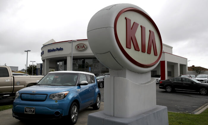 A sign with the Kia logo displayed at a Hyundai dealership in San Leandro, Calif., on April 7, 2017. (Justin Sullivan/Getty Images)