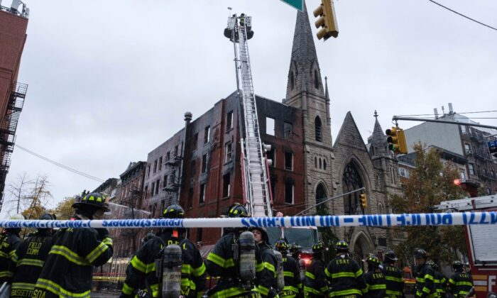 Firefighters work to extinguish the fire erupted from a building next to the Middle Collegiate Church in N.Y., New York, Dec. 5, 2020. (Yuki Iwamura/AP Photo)