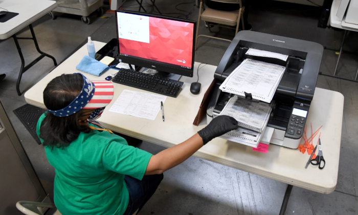 A Clark County election worker scans mail-in ballots at the Clark County Election Department in North Las Vegas, Nevada, on Nov. 7, 2020. (Ethan Miller/Getty Images)