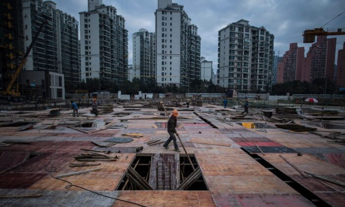 A man works at a construction site of a residential skyscraper in Shanghai on Nov. 29, 2016. (Johannes Eisele/AFP via Getty Images)