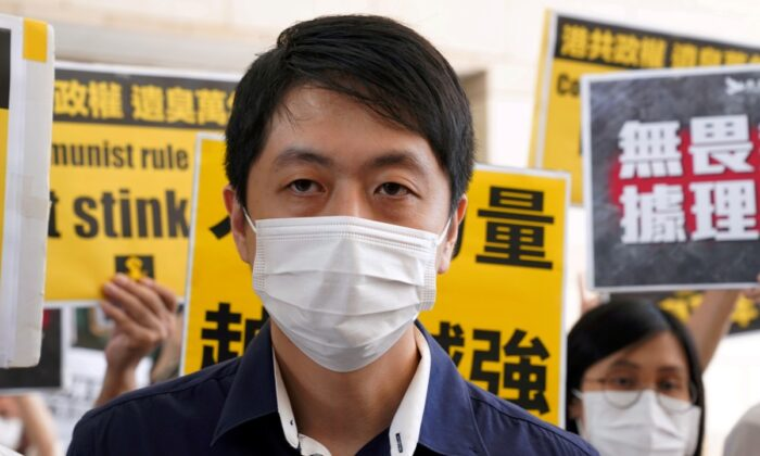Former pro-democracy lawmaker Ted Hui Chi-fung appears outside West Kowloon Magistrates' Courts in Hong Kong, China Nov. 19, 2020. (Lam Yik/Reuters)