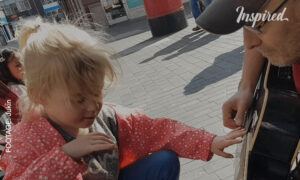 Seven-Year-Old Blind Girl Plays the Guitar With Busker