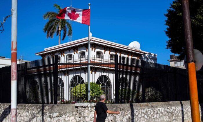 In this April 17, 2018 file photo, a man walks beside Canada's embassy in Havana, Cuba. (AP Photo/Desmond Boylan, File)