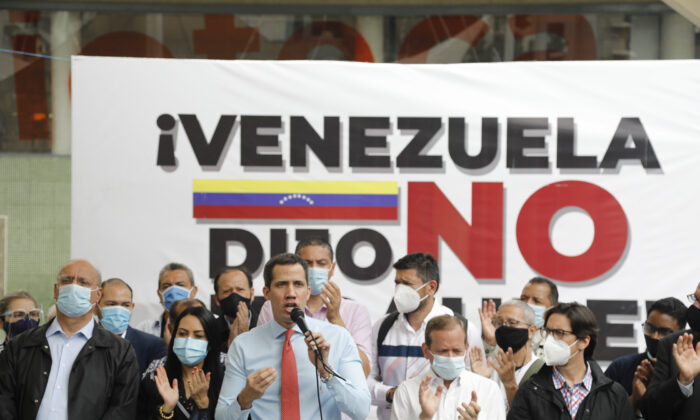 Flanked by party members, Venezuelan opposition leader Juan Guaido speaks during a press conference, a day after parliamentary elections, in Caracas, Venezuela, on, Dec. 7, 2020. (Ariana Cubillos/The Associated Press)